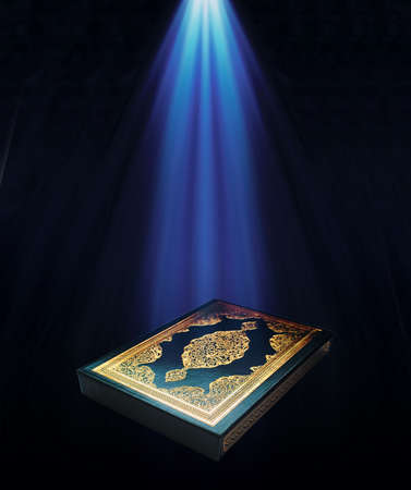 book of revelation: A KURAN-I KERIúM under a light.  Stock Photo