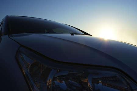 a blak car with sunset
