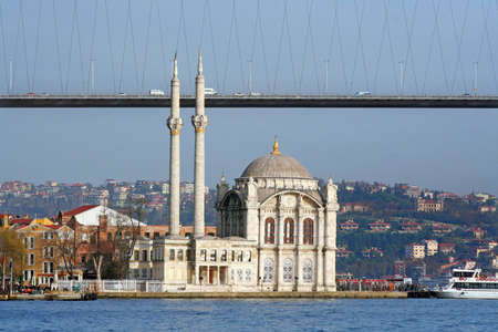 Iústanbul Bosphorus Bridge with a mosgue at coast side Stock Photo