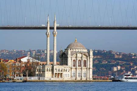 I�stanbul Bosphorus Bridge with a mosgue at coast side