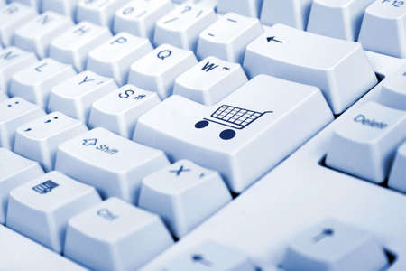 add to basket: Computer Keyboard from a desktop computer with the enter key highlighted in green with a small shopping cart on it
