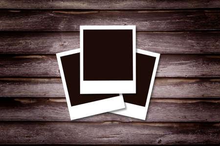 Historical polaroid photo conceptWooden background photo frame. Stock Photo - 3497477