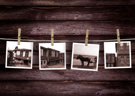 Historical turkish house photo concept.rOld Polaroid Film Blanks Hanging on a Rope Held By Clothespinsr Stock Photo