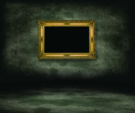 dungeon: An empty dark dungeon wall. Golden picture frame on wall Stock Photo