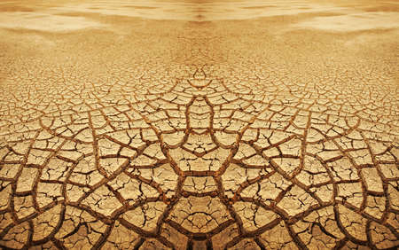 Cracked earth background. Cracked and dried mud texture Stock Photo