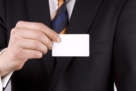 Business hands, man in suit. Business card sign note. Stock Photo