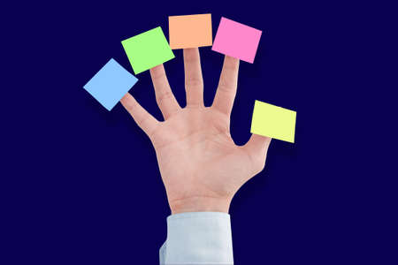 tasks: Business man hand with blank notes, just add your messages.  Post five business concept. Stock Photo