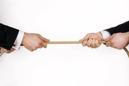 tug of war: Business competition over white. (in cluding ) Stock Photo