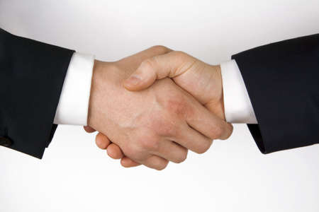 Business handshake. Image of businesspeople handshake on the white background. Stock Photo - 5248547