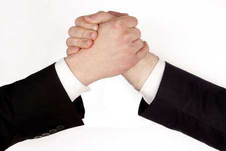 Business man competition... Business rivalry. Two hands, arm wrestling, isolated on white background