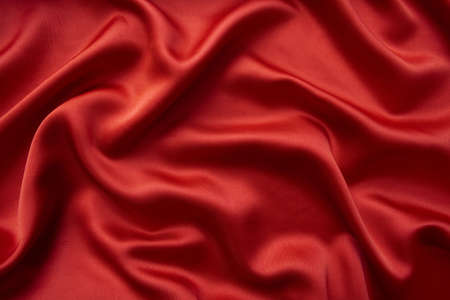 Red silky background. Highly detailed red silk texture. Natural textile texture.