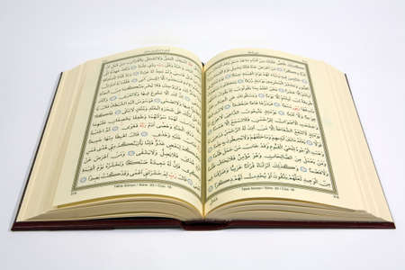 Holy Koran with isolated. Verse of the koran. Stock Photo