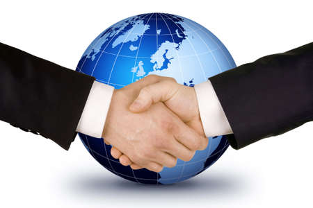 shake hands: Business handshake. Image of businesspeople handshake on the world globe background,