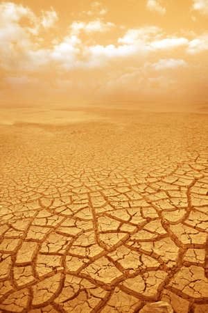 Droughty ground and hot weather background. Cracked earth and weather background. photo
