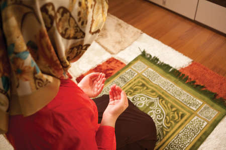 islamic pray: Muslim woman is praying in the house. Muslim woman praying.
