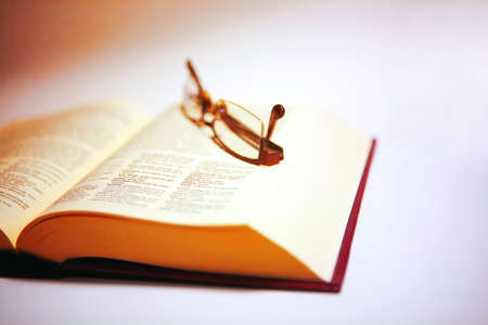 Wisdom. Book and glasses. Stock Photo