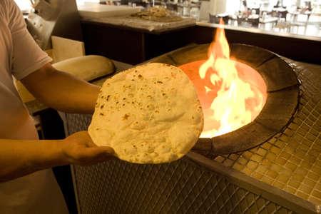 turkish bread: Brick lavash oven. Cooker bread oven.