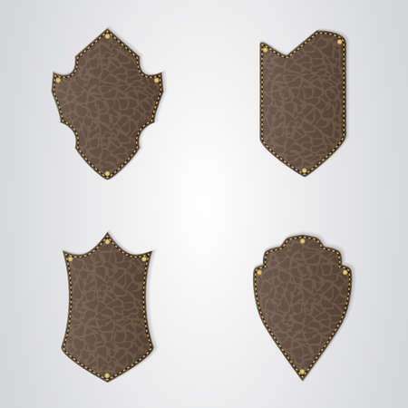 brown leather: Set of four brown leather shield with gold thread. Vector