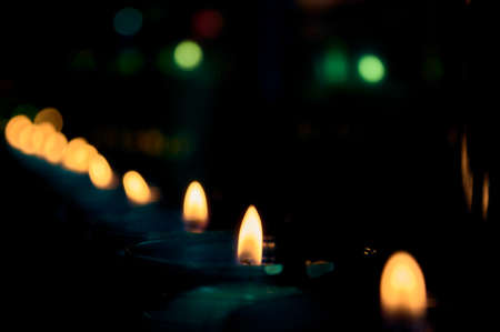 unfocused set of religious candles in a mountain sanctuary