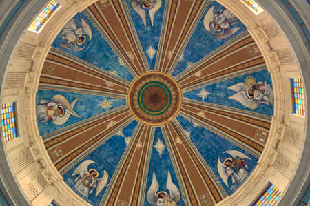detail of the fresco and stained glass of the dome of a church 版權商用圖片