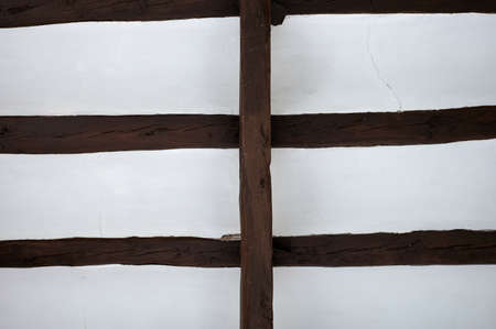 detail of old wooden beams forming a roof structure