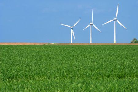 3 Wind turbines in a green landscape