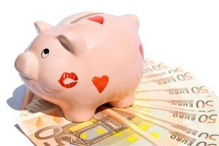 Piggy bank with fifty euro notes on white background  photo