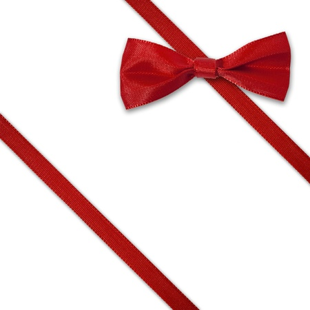 Red diagonal ribbon with bow on white background  photo