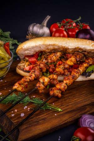 Appetizer chicken kebab sandwich with vegetables