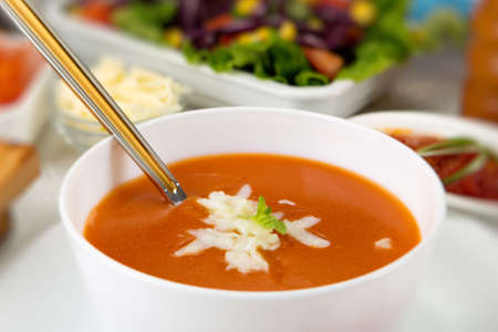 Tomato soup with cheese on it