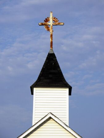 Cross on top of a country church
