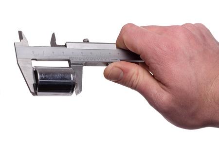 sliding caliper: Measuring a metall objekt with a caliper.