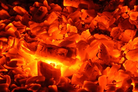 glut: A lot of glowing charcoals in a chimney.