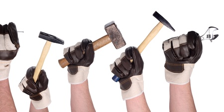 A set of working hands in gloves with different tools.
