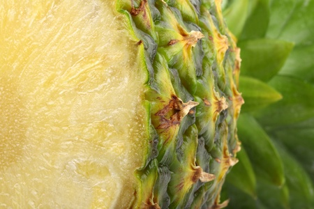 Cutted fresh pineapple fruit in frontal view.