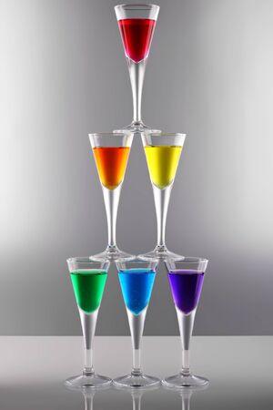 rainbow cocktail: A row of drinks in rainbow colours