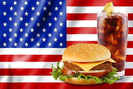 cheeseburger and soda in front of the american flag.