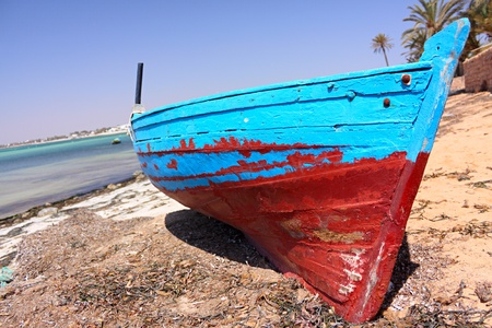 yellow boats: Fishing boat in a natural harbour in africa. Stock Photo