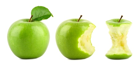 row of green granny smith apples on white background