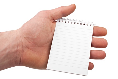 scratchpad: hand holding a notepad on isolated white background. Stock Photo