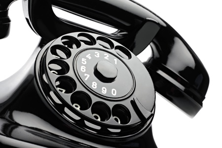 an old telephon with rotary dial photo