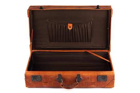 An old leather opened suitcase on white background photo