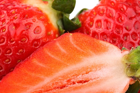 a closeup of slice of strawberry and whole fruits. Stock Photo - 10061382