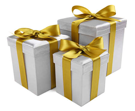 three gift boxes: group of silver presents with a golden ribbon on white background Stock Photo