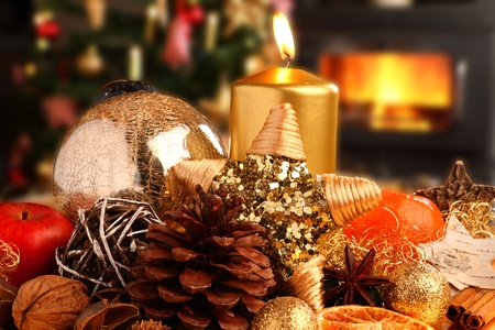 chistmas decoration in front of tree and fireplace. Stock Photo - 11312244
