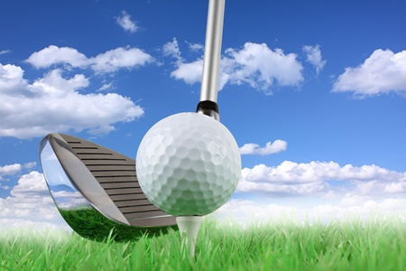 golf: golf club with ball and tee on green in front of blue cloudy sky