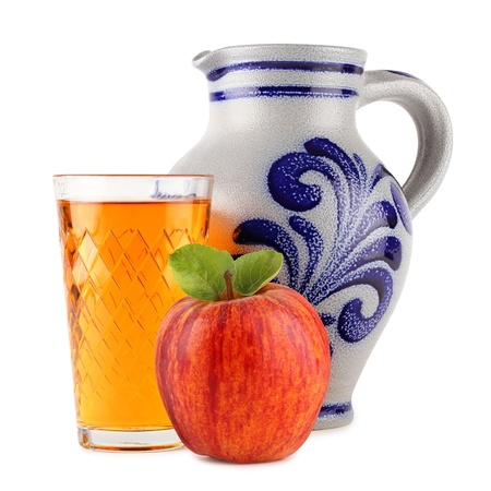 cider: apple wine glass with apple in front of earthenware jug