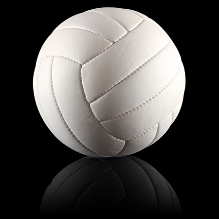a white volleyball on black background photo