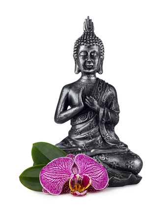 buddha sculpture with orchid blossom photo