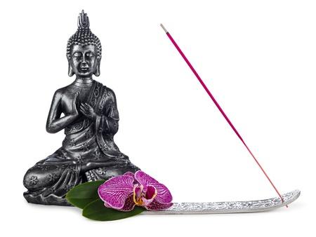 incienso: escultura de Buda de incienso palo y flor de la orquídea Foto de archivo
